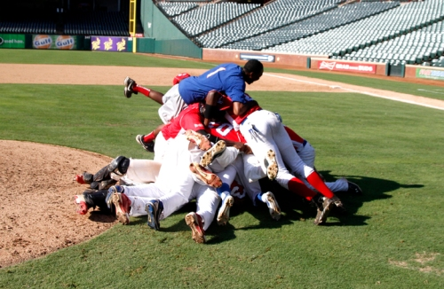 Mississippi RBI players dogpile in Rangers Ballpark